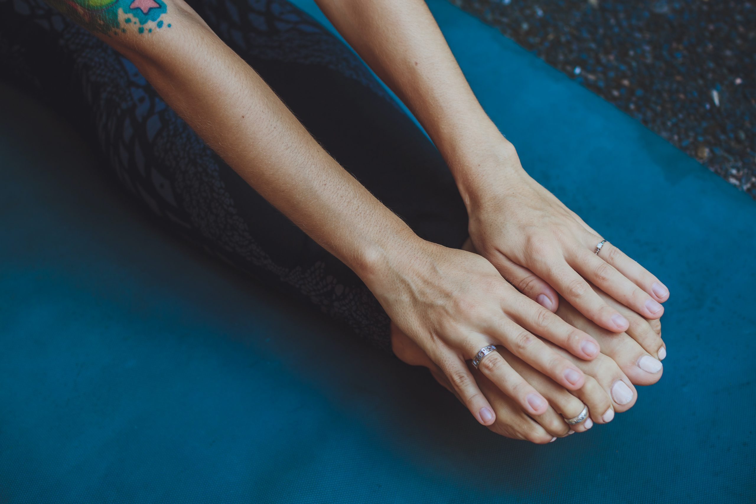 Woman stretching legs and arms